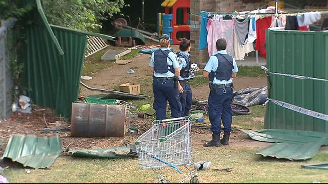 Police at the scene where the car tore through a suburban back yard. Picture: Supplied