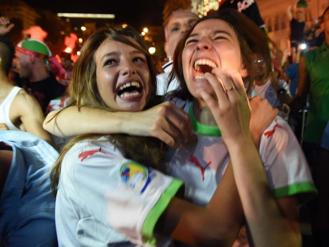 Fans of Alergia react during a public screening of Algeria's 2014 FIFA World Cup match against Germany.