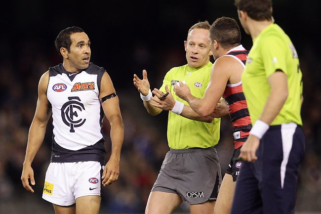 Umpire Ray Chamberlain talks with Leigh Montagna after Eddie Betts cleaned up Nathan Wright during the 3rd quarter of the St Kilda vs Carlton match at the Etihad Stadium, Melbourne. May13, 2013. Picture: Klein Michael