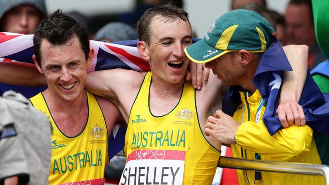 Steve Moneghetti (right) with Michael Shelley after the Aussie won the marathon in one of the highlights of the Games so far. Picture: Adam Head