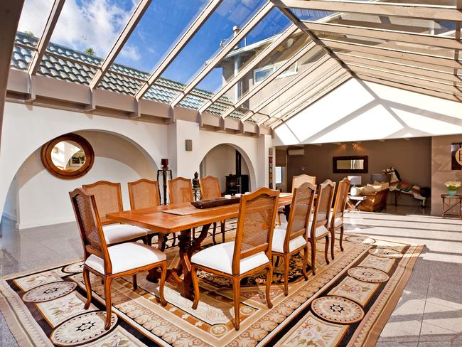The dramatic dining room with glass atrim roof in Gilwinga Drive, Bayview