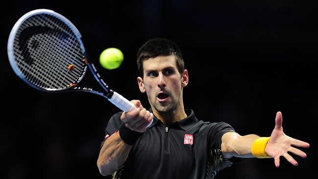 Novak Djokovic hits a return in his win over Argentina's Juan Martin Del Potro at the ATP World Tour Finals in London. Picture; Glyn Kirk