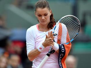 Poland's Agnieszka Radwanska reacts during her women's fourth round match against Bulgaria's Tsvetana Pironkova at the Roland Garros 2016 French Tennis Open in Paris on May 31, 2016. / AFP PHOTO / PHILIPPE LOPEZ