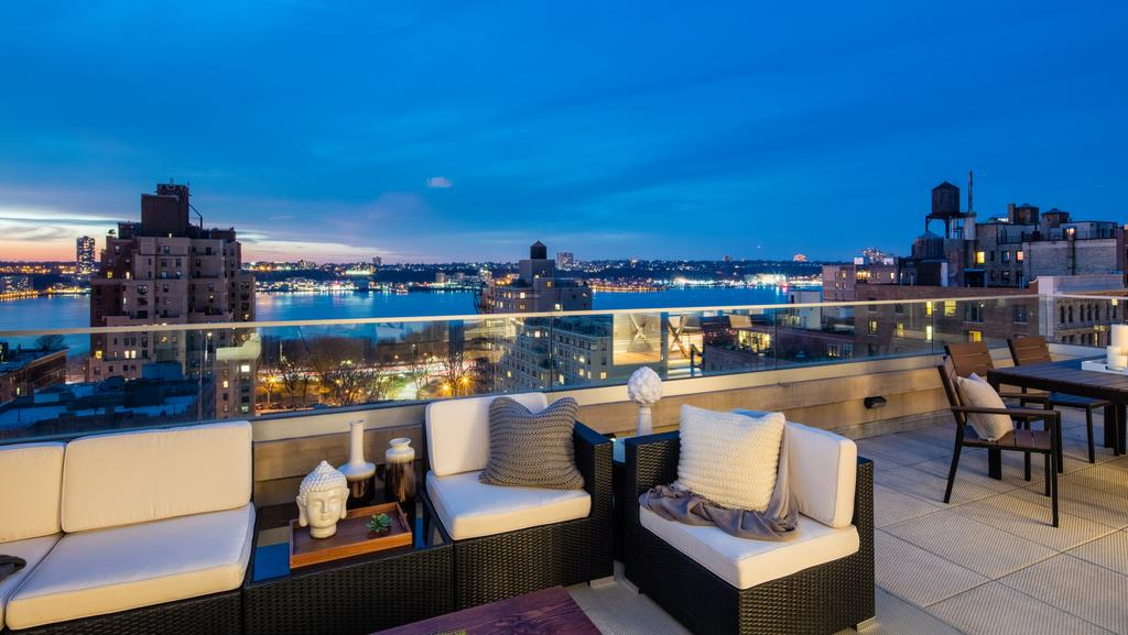 New york luxury properties for sale the courier mail for Luxury real estate in new york