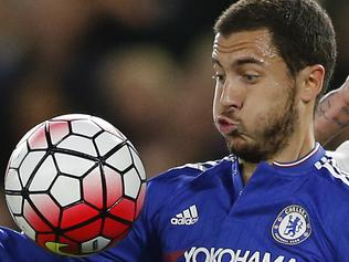 Chelsea's Eden Hazard, left, vies for the ball with Tottenham's Kyle Walker during the English Premier League soccer match between Chelsea and Tottenham Hotspur at Stamford Bridge stadium in London, Monday, May 2, 2016. (AP Photo/Frank Augstein)