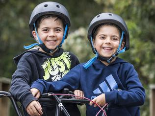 Twins and Bikes and Helmets
