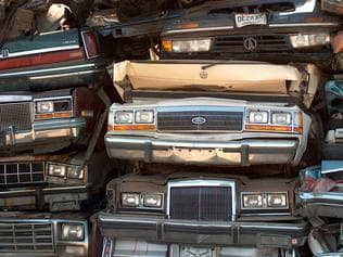 Pile of wrecked cars stacked for stredding in the US, in generic photo for Sims Group, to promote their record scrap metal profit.