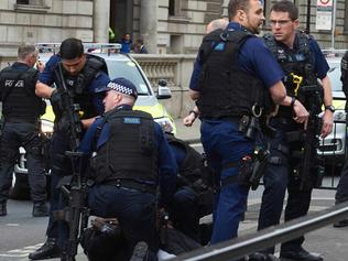 Firearms officiers from the British police detain a man on the ground on Whitehall near the Houses of Parliament in central London on April 27, 2017 before the man was taken away by police. Metropolitan police attended an incident on Whitehall in central London near the Houses of Parliament where one man was arrested, police said. / AFP PHOTO / Niklas HALLE'N