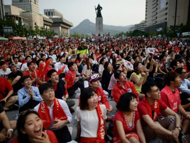 South Korean football fans react as they watch a public screening in Seoul of the 2014 World Cup match against Russia.