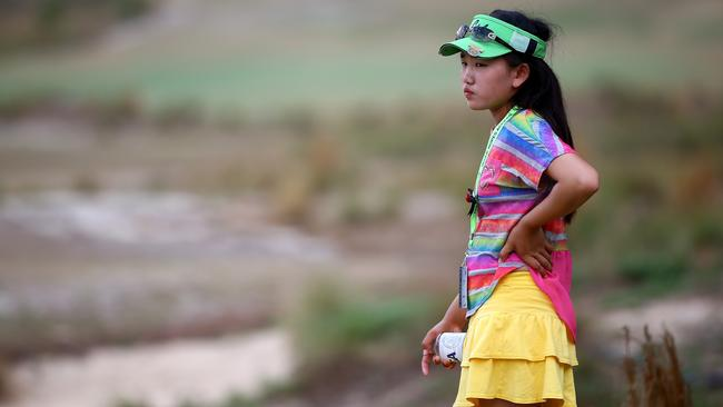 Eleven-year old Amateur Lucy Li of the United States watches the final group of Lexi Thompson and Michelle Wie during the third round of the 69th U.S. Women's Open at Pinehurst Resort & Country Club, Course No. 2.