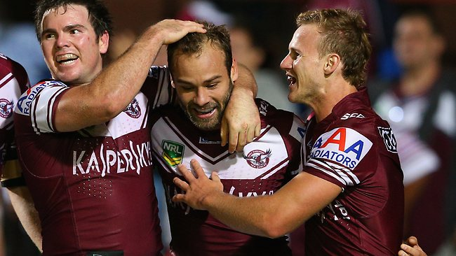 Brett Stewart is congratulated after crossing for the Sea Eagles.