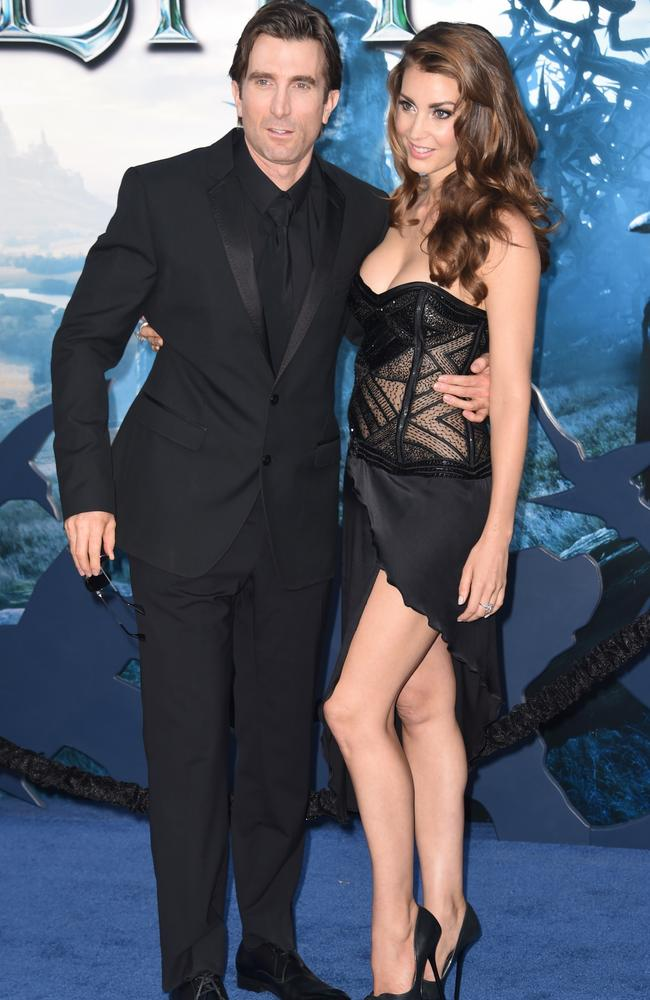 Sharlto Copley and girlfriend Tanit Phoenix at the world premiere of Disney's  <i>Maleficent</i>.