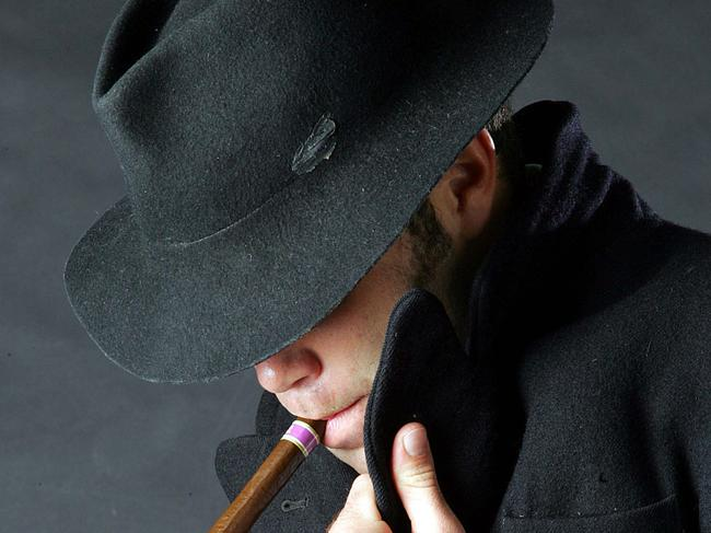 11/02/2005 PIRATE: 11 Feb 2005 QNPL staff journalist Patrick Watson dressed as a spy. PicAnnette/Dew espionage spying smoking cigar hat generic situation