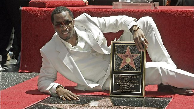 Diddy poses with his star on the Hollywood Walk of Fame.