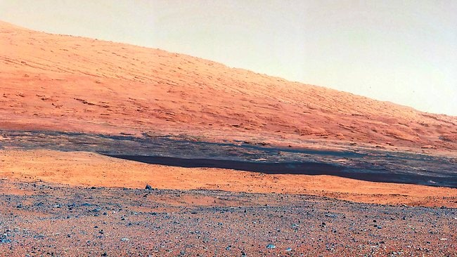 This image released by NASA, highlights the geology of Mount Sharp, a mountain inside Gale Crater, where the rover Curiousity landed on Mars. (AP Photo/NASA/JPL-Caltech/MSSS)