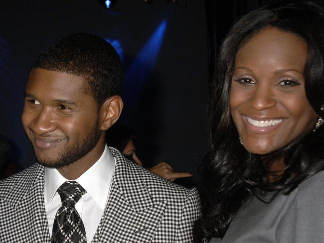 Usher with ex-wife Tameka Foster in 2007. Picture: AP/John Smock