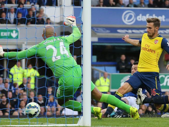 Aaron Ramsey pokes him Arsenal's first goal.