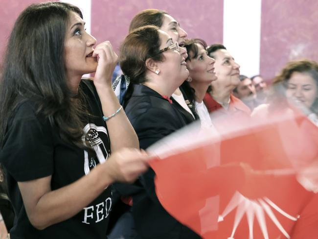 People react while watching a live broadcast of the Turkish referendum results during an event in Berlin. Picture: Sebastian Willnow/AP