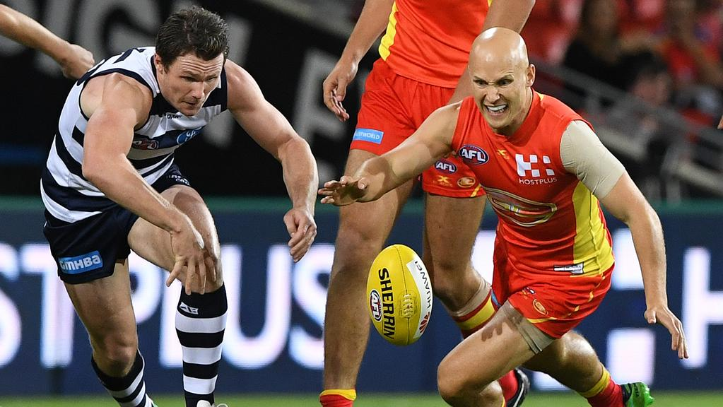 Patrick Dangerfield and Gary Ablett battle for the ball.