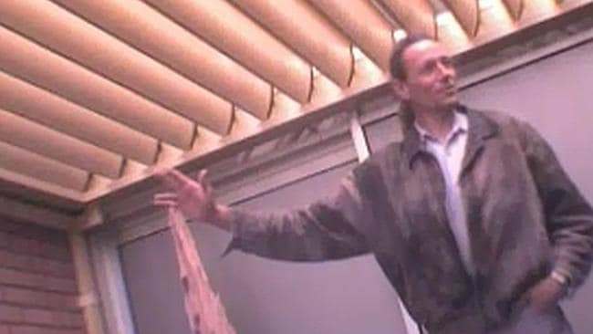 Brett Peter Cowan speaks to an undercover police officer who he thought was a gang boss on the balcony of a room at the Hyatt Perth in August 2011.