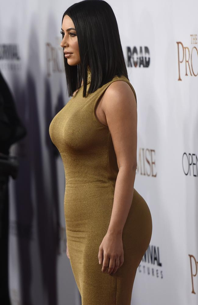 The gold gown shows off Kim's famous curves.