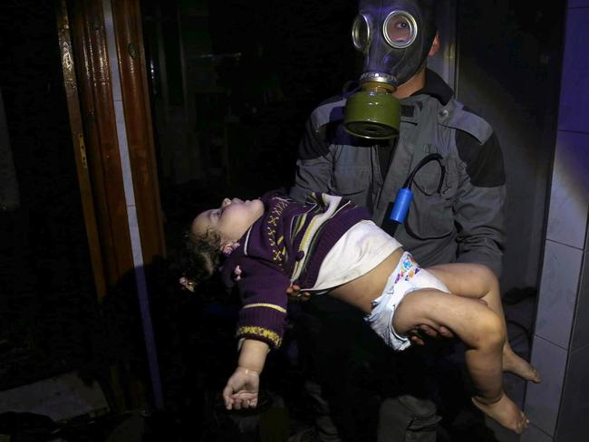 Residents said the gas made them lose control of their bodies and collapse to the ground, foaming at the mouth and convulsing. Picture: Syrian Civil Defence White Helmets via AP, File