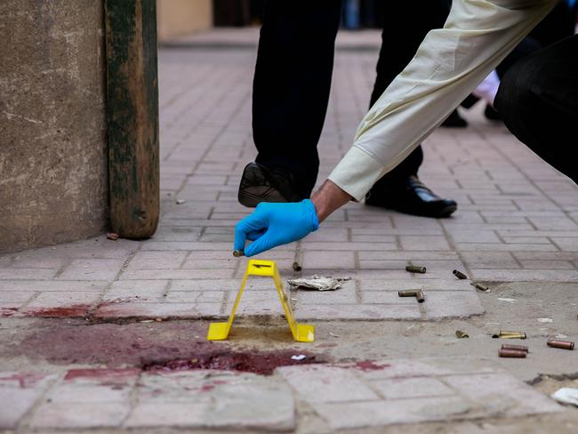 Blood stains and bullet casings outside the church. Picture: AFP/Samer Abdallah