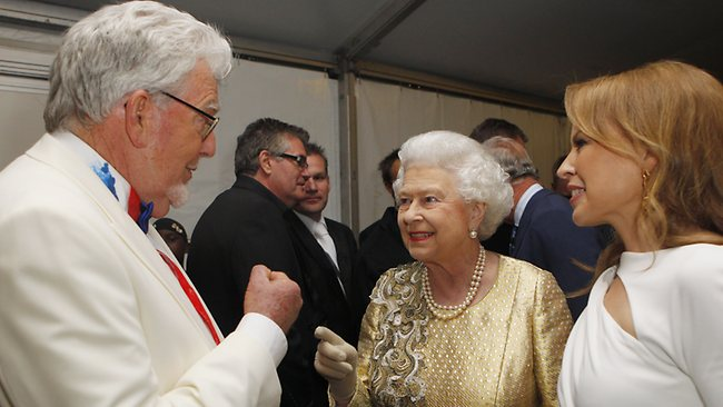 FILE PHOTO: Australian entertainer Rolf Harris is to be charged with nine counts of indecent assault and four counts of making indecent images of a child LONDON, ENGLAND - JUNE 04: Queen Elizabeth II talks with Rolf Harris (L) and Kylie Minogue (R) backstage after the Diamond Jubilee Buckingham Palace Concert June 04, 2012 in London, England. For only the second time in its history the UK celebrates the Diamond Jubilee of a monarch. Her Majesty Queen Elizabeth II celebrates the 60th anniversary of her ascension to the throne. Thousands of well-wishers from around the world have flocked to London to witness the spectacle of the weekend's celebrations. (Photo by Dave Thompson - WPA Pool/Getty Images)