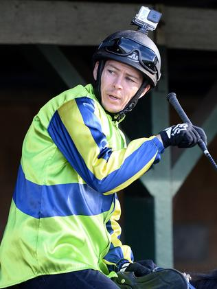 Jockey Andrew Gibbons armed with a GoPro before heading out to work over 900m. Picture: Peter Lorimer
