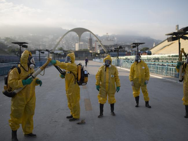 On call ... Health workers fumigae the area around the Sambadrome to stop the spread of the Zika virus. Picture: AP Photo/Leo Correa