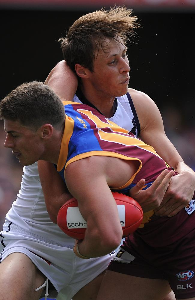 Dayne Zorko is tackled by Cameron Sutcliffe. The Dockers' pressure was relentless. Picture: Getty Images