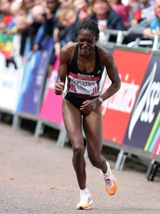 Namibian Athlete Beata Naigambo struggles to the finish in the Women's marathon at Glasgow Green. Picture: Adam Head