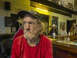 Long time Cooktown resident Roy McGeffie waits out the arrival of Cyclone Ita in the 'middle pub' - the West Coast Hotel. Picture: Brian Cassey