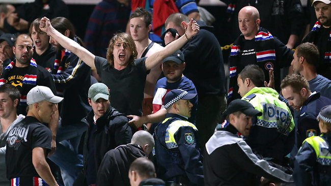 Sydney United FC fan chants as police move in to eject troublemakers. Picture: Gregg Porteous