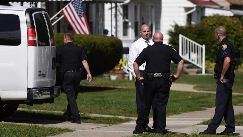 Police investigate at a home where two children were shot in Dearborn, Michigan. Picture: Tanya Moutzalias /The Ann Arbor News via AP