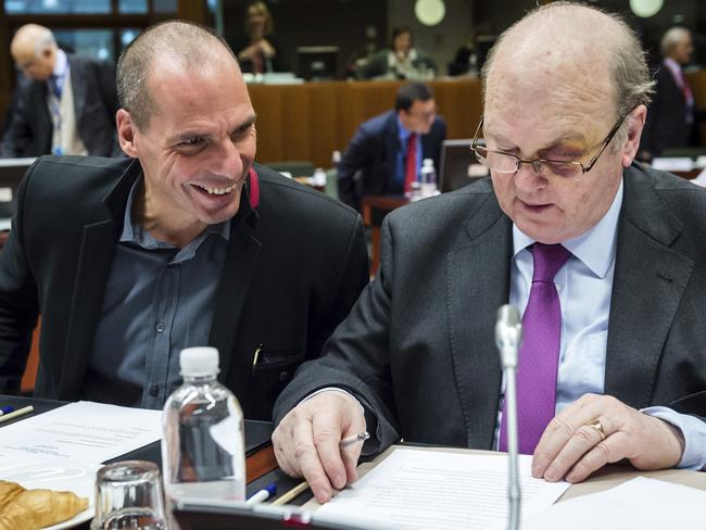 No deal ... Greece's Finance Minister Yanis Varoufakis, left, talks with Irish Finance Minister Michael Noonan during a meeting of EU finance ministers at the EU Council building in Brussels. Picture: AP