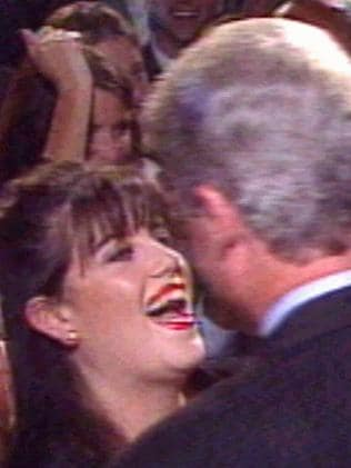 CNN TV video still from 1996 of former White House intern Monica Lewinsky greeting former US President Bill Clinton at time of their affair.