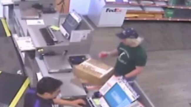 The suspect was pictured dropping off parcel bombs at a FedEx store