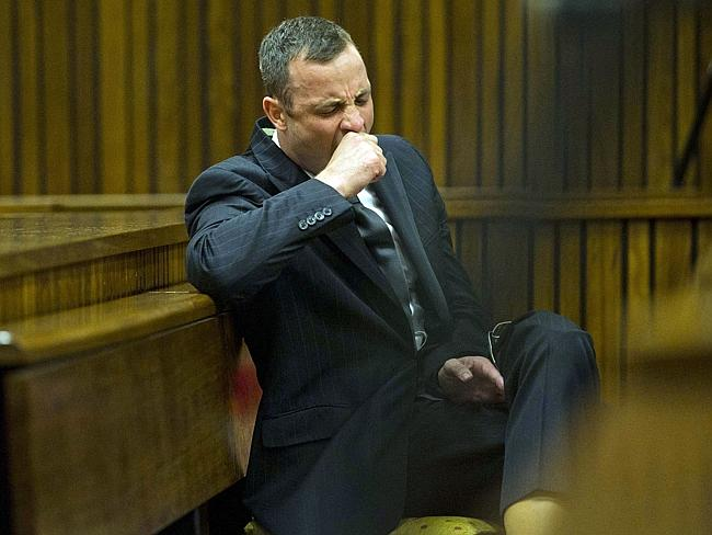 Long trial ... Oscar Pistorius yawns as he listens to forensic evidence being given in court in Pretoria. Picture: AP