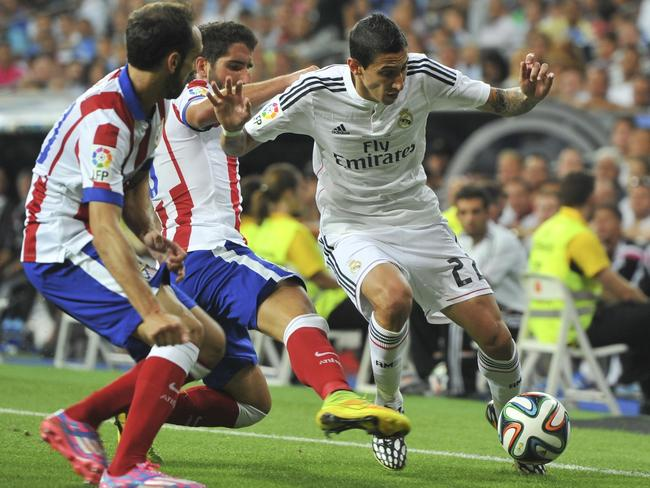 Angel di Maria (R) playing for Real Madrid against Atletico Madrid during the Spanish Super Cup.