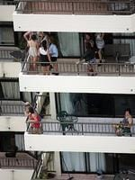 <p>Schoolies gather on high-rise balconies. Picture: Marc Robertson</p>
