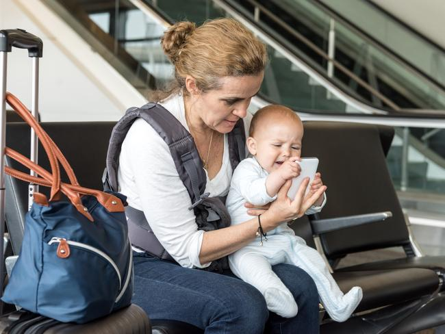 Flying with babies involves careful planning. A phone is also handy. Picture: IStock