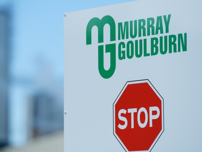 A car parking stop sign for the Murray Goulburn manufacturing facilities behind houses in Rochester, Wednesday, May 3, 2017. (AAP Image/Tracey Nearmy) NO ARCHIVING