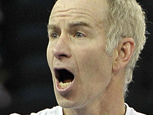 21/11/2008 WIRE: 21/11/2008 WIRE: Veteran US tennis player John McEnroe objects to a line call during a game against Swedish opponent Bjorn Borg in The Venetian Tennis Showdown in Macau on November 20, 2008. Bjorn Borg gained revenge over former arch-rival John McEnroe, winning their one-set clash 7-6 after the American beat the Swede earlier in the week in Kuala Lumpur. AFP PHOTO/MIKE CLARKE