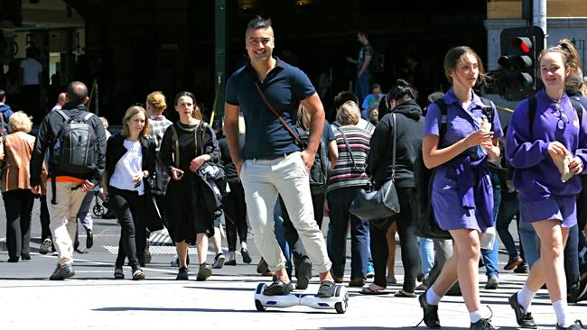 Motorised skateboard transport ... Tony Tran, director of Australasian Innovations, rides his skateboard through the Melbourne CBD. Picture: Tim Carrafa