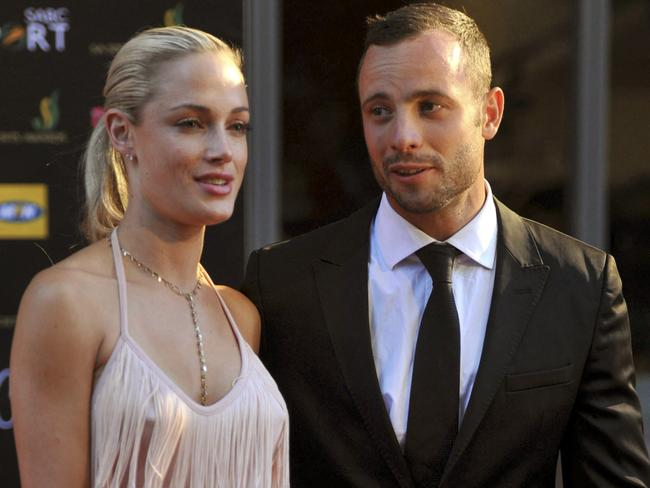 A happy couple no more ... Oscar Pistorius and former girlfriend Reeva Steenkamp. Picture: AP