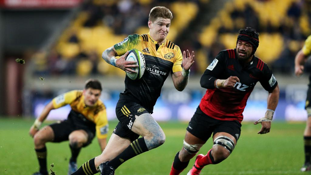 Jordie Barrett of the Hurricanes breaks away for a try at Westpac Stadium.