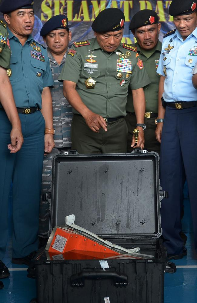 Crucial find ... Indonesian Military Chief General Moeldoko points to the Flight Data Recorder of the AirAsia flight QZ8501 on board navy vessel KRI Banda Aceh at sea. Picture: Adek Berry