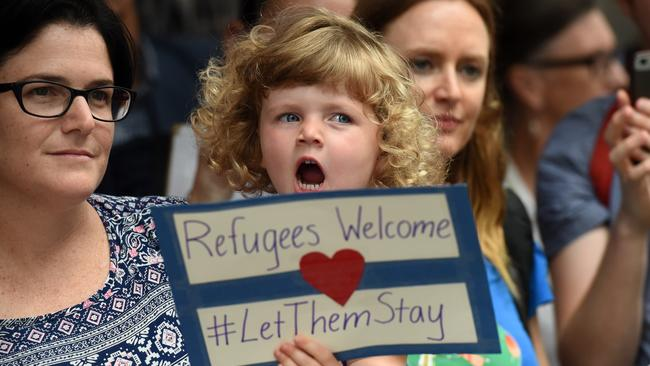 Pro-refugee protesters attend a rally outside the Immigration Office in Brisbane on Friday. Picture: AAP Image/Dan Peled