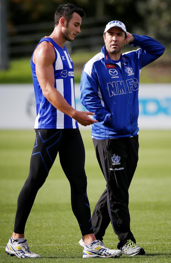 Kangaroos forward Robbie Tarrant in talks with coach Brad Scott. Picture: Colleen Petch
